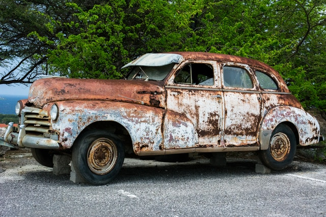 Broken Down Rusty Car Parking